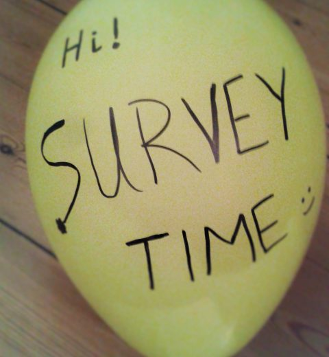 "photo with a balloon in which it is written ""survey time"" for the e-mail marketing technique"